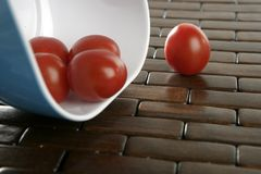 Cherry tomatoes in blue bowl Royalty Free Stock Photo