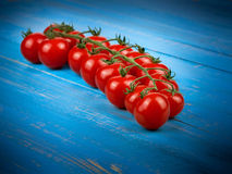 Cherry tomatoes. On blue wooden background Stock Image