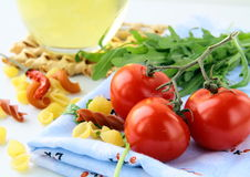 Cherry tomatoes and a bottle of olive oil Stock Photos