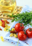 Cherry tomatoes and a bottle of olive oil Stock Image