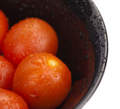 Cherry tomatoes in a bowl. On white Stock Photos