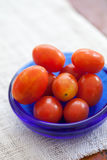 Cherry tomatoes. On a bowl Stock Photography