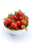Cherry Tomatoes in Bowl Isolated on White Stock Image
