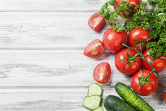 Cherry tomatoes on a branch, cucumber, parsley Royalty Free Stock Image