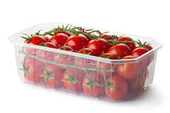 Cherry tomatoes on a branch in retail packaging Royalty Free Stock Photos