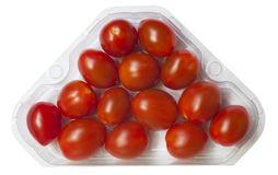 Cherry tomatoes on a branch in retail packaging. Royalty Free Stock Photos