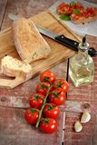 Cherry tomatoes with bread, oil and garlic Stock Photo