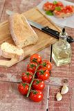 Cherry tomatoes with bread, oil and garlic Royalty Free Stock Photography