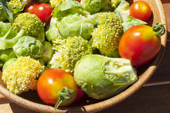 Cherry tomatoes, brussels sprouts with broccoli Royalty Free Stock Photos
