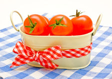 Cherry tomatoes in a bucket with a bow Royalty Free Stock Image