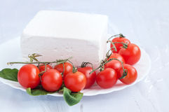 Cherry tomatoes and bulgarian white cheese. In a plate Stock Photo