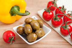 Cherry tomatoes bunch, olives, yellow paprika, on Royalty Free Stock Photo