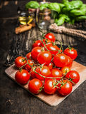 Cherry tomatoes bunch with water drops Royalty Free Stock Photography