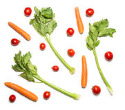 Cherry tomatoes, celery and carrots isolated on white top view. Vegetable pattern or background Royalty Free Stock Photo
