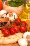 Cherry tomatoes, champignons, spices Royalty Free Stock Image