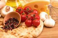 Cherry tomatoes, champignons, spices Royalty Free Stock Photography