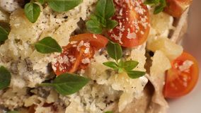 Cherry tomatoes, cheese and basil on pasta. Video. Horizontal stock video footage