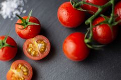 Cherry tomatoes with salt royalty free stock images