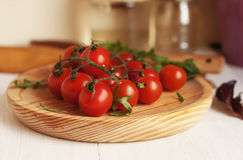 Cherry tomatoes . Cherry tomatoes on a wooden kitchen board. Cherry tomatoes on a wooden kitchen board Stock Photo