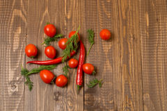 Cherry tomatoes , chilli and dill Stock Photography