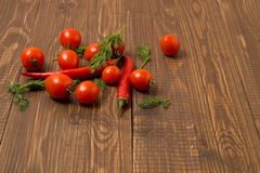 Cherry tomatoes , chilli and dill Stock Images