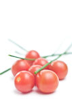 Cherry tomatoes with chive. On white Royalty Free Stock Image