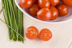 Cherry tomatoes and chives Stock Images