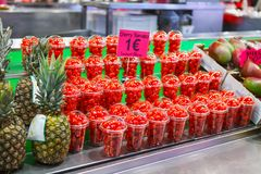 Cherry Tomatoes in Clear Cups in Farmers Market royalty free stock images