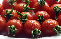 Cherry tomatoes close-up. Delicious cherry tomatoes with water drops Stock Photo