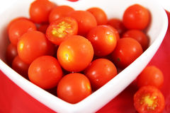 Cherry tomatoes close up. Vibrant red. Royalty Free Stock Photography