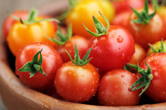 Cherry Tomatoes close up with water drops Royalty Free Stock Photos