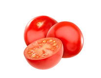 Cherry tomatoes closeup, isolated on white. Group of very fresh cherry tomatoes isolated on a white background, with clipping path Stock Photos