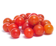 Cherry tomatoes. Closeup of some cherry tomatoes on a white background Stock Photography