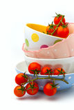 Cherry tomatoes in colorful bowls Stock Photos