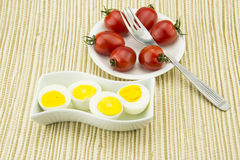 Cherry Tomatoes,Cooked eggs,Tableware, fork Royalty Free Stock Images