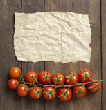 Cherry tomatoes and craft paper Royalty Free Stock Photos
