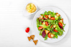 Cherry tomatoes, croutons, capelin roe, mixed lettuce leaves, to Stock Photography