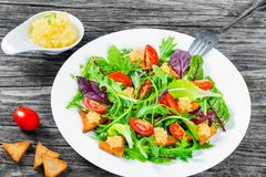 Cherry tomatoes, croutons, capelin roe, mixed lettuce leaves, top view Stock Photography