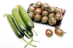 Cherry tomatoes with cucumber Stock Photography