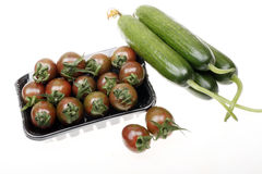 Cherry tomatoes with cucumber Royalty Free Stock Photo