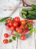 Cherry tomatoes and cucumber Royalty Free Stock Photography