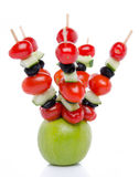 Cherry tomatoes, cucumber and olives on skewers pricked into an Royalty Free Stock Photo