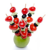 Cherry tomatoes, cucumber and olives on skewers pricked into an Royalty Free Stock Photography