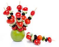 Cherry tomatoes, cucumber and olives on skewers pricked into an stock photography