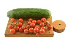 Cherry tomatoes with cucumbers Stock Images