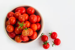 Cherry tomatoes are in a cup on a white background. Fresh cherry tomatoes are in a cup on a white background stock images