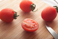Cherry Tomatoes on cutting board Stock Images