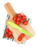 Cherry tomatoes on cutting board Stock Photography