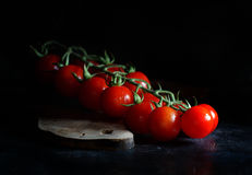 Cherry tomatoes on a dark background Stock Photography