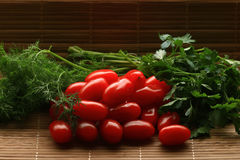 Cherry tomatoes with dill and parsley Royalty Free Stock Photos